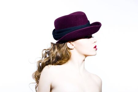 Beautiful young model in hat on the white background. Contrast photo Stock Photo - 6834713