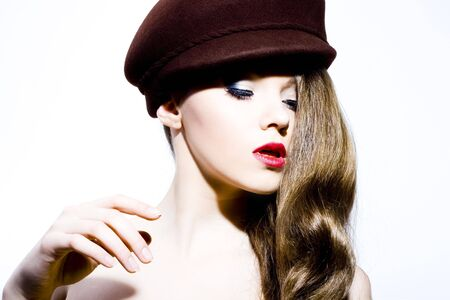 Beautiful young model in hat on the white background. Contrast photo Stock Photo - 6834720