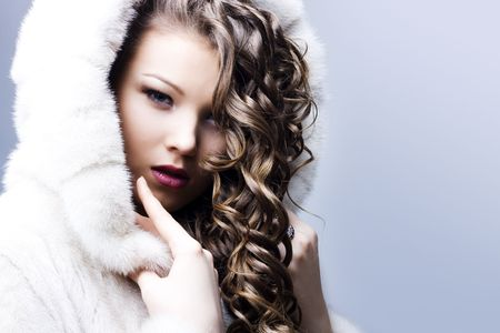 portrait of a beautiful lady in fur coat