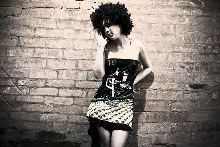 Fashion art photo. The beautiful young girl. Retro styled photo