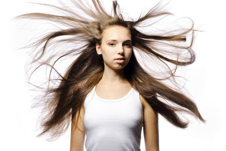 Portrait of a beautiful girl with flying hair photo