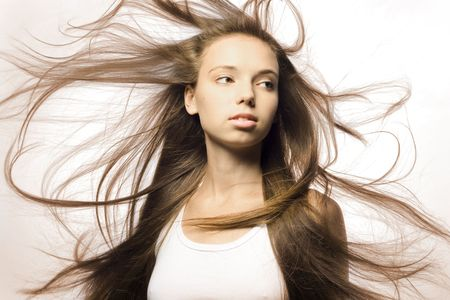 Portrait of a beautiful girl with flying hair Stock Photo - 7525738