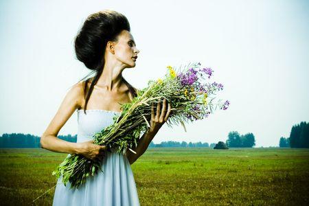 Portrait of beautiful girl in green field Stock Photo - 7525753