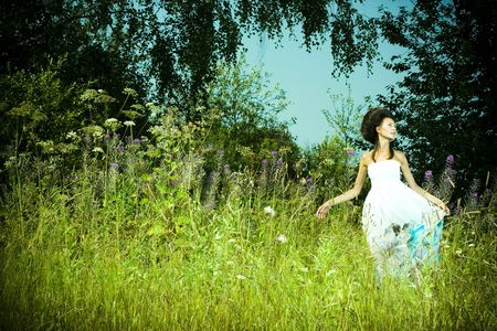 Portrait of beautiful girl in green meadow