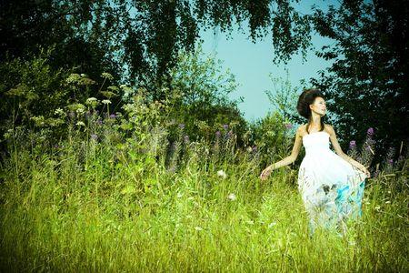 Portrait of beautiful girl in green meadow