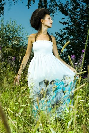 Portrait of beautiful girl in green field Stock Photo - 7525762