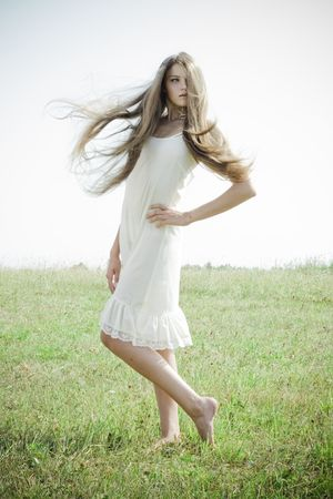 Beautiful girl with luxuriant hair outdoor