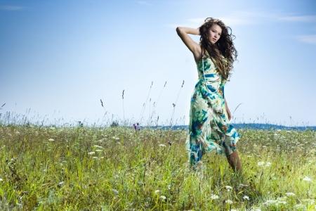 Portrait of beautiful girl in green field Stock Photo - 7525760