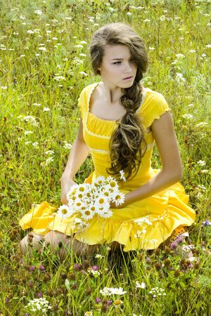 Portrait of beautiful girl in green field photo