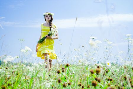 Portrait of beautiful girl in green field Stock Photo - 7525752