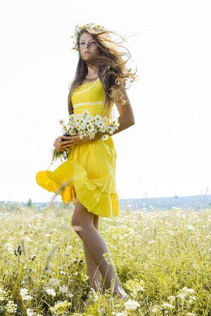 Portrait of beautiful girl in green field Stock Photo - 7525758