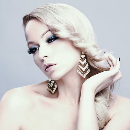 hair and beauty: Beautiful blond woman. Pretty girl with long hair. Jewelry and Beauty. Fashion art photo
