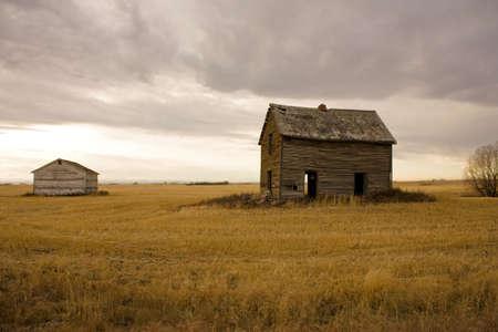 Abandoned farm house and barn photo