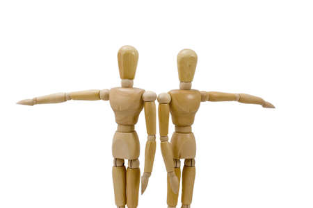 Two wooden figures pointing in opposite directions