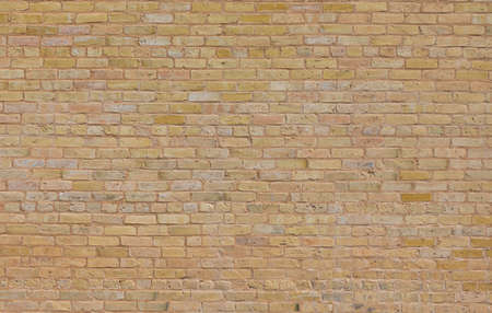 Tan brick texture pattern taken during the day Standard-Bild