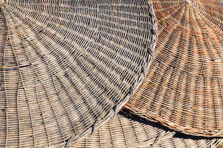 sunshades: Traditional woven beach sunshades Stock Photo
