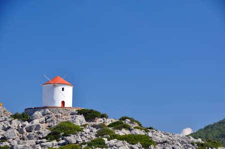 traditional windmill: Traditional windmill, Panormitis Monastery, Symi, Rhodes, Greece  Stock Photo