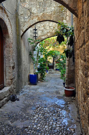 Arched courtyard in Old Town, Rhodes, Greece  Stock Photo