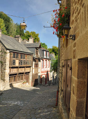 rue: Medieval half-timbered buildings in the ancient french town of Dinan in Brittany. These old houses are in the Rue de Jerzual, which leads into the Rue du Petit Port and then to the River Rance ~ probably the street most visited by tourists
