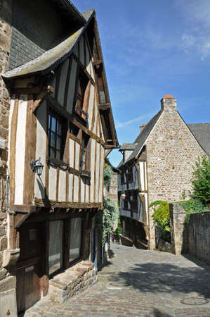 dinan: Medieval half-timbered buildings in the ancient french town of Dinan in Brittany.  Stock Photo