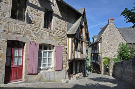 dinan: Medieval half-timbered buildings in the ancient french town of Dinan in Brittany. These old houses are in the Rue de Jerzual, which leads into the Rue du Petit Port and then to the River Rance ~ probably the street most visited by tourists