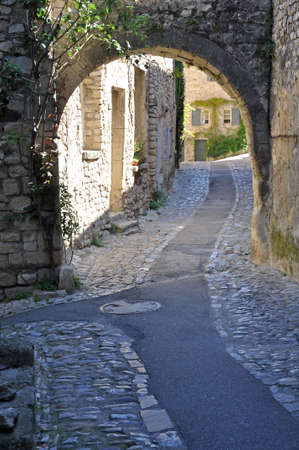 provencal: A small road in the old medieval village of Vaison-la-Romaine, in Provence, France. (taken in the Haute Ville)