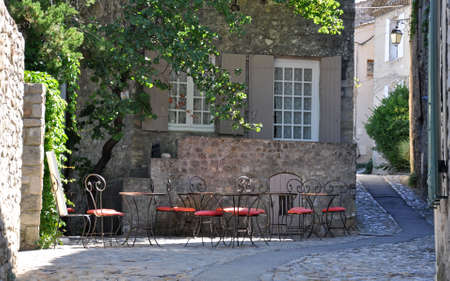 provencal: A cafe in the old medieval village of Vaison-la-Romaine, in Provence, France. (taken in the Haute Ville)