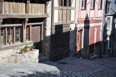 rue: Medieval half-timbered buildings in the ancient french town of Dinan in Brittany. These old houses are in the Rue de Jerzual, which leads into the Rue du Petit Port and then to the River Rance.