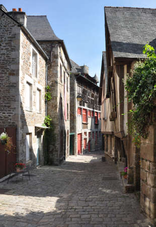 rance: Medieval buildings in the ancient french town of Dinan in Brittany. These old houses are in the Rue du Petit Port which leads to the River Rance and port area of the town. Stock Photo