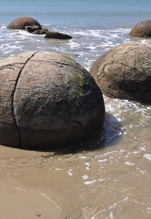 oamaru: Moeraki Boulders are perfectly spherical rocks on the beach at Moeraki, north of Dunedin, near Oamaru. Up to 13 feet round Maori believe they were food baskets on the original Maori canoe