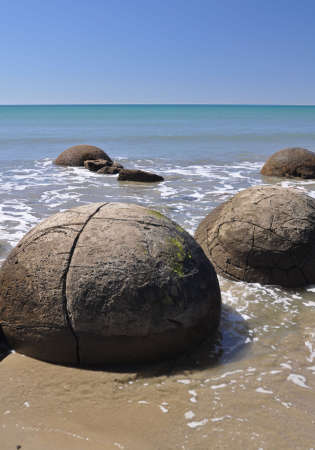 oamaru: Moeraki Boulders are perfectly sperical rocks on the beach at Moeraki, north of Dunedin, near Oamaru. Up to 13 feet round Maori believe they were food baskets on the original Maori canoe