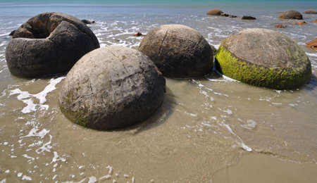 oamaru: Moeraki Boulders are perfectly spherical rocks on the beach at Moeraki, near Oamaru. Up to 13 feet round Maori believe they were canoe food baskets. Stock Photo