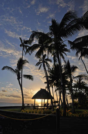 south pacific ocean: The tranquil beaches of the  South Pacific Ocean really are paradise found. This sunset is over the Coral Coast on the island of Viti Levu (Fiji)