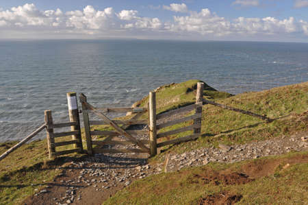 baggy: Southwest Coast footpath at Baggy Point headland, Croyde, North Devon, England, a popular walk throughout the year, ths Island of Lundy is visible on the horizon Stock Photo