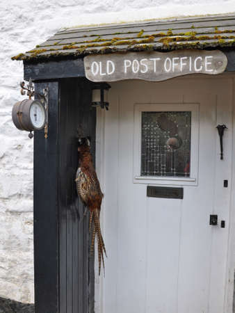countrylife: An old English Post Office, now a rural cottage, complete with hanging pheasant in the porch,and a wall mounted barometer. Quintessential rural England