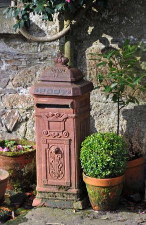 An old ornate garden post box photo