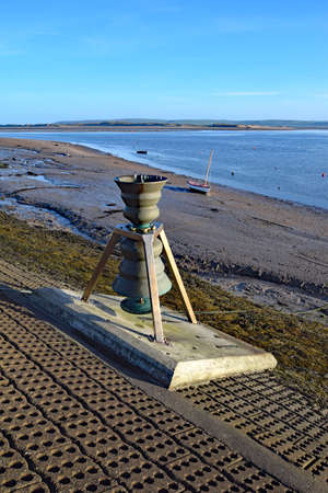 Appledore, Devon, England, UK - 5th April 2017. The  Time and Tide Bell was the first if 5 brass installations by Marcus Vergette around the coast of the UK. The pitch of the bell varies as the tide rises