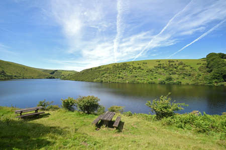 Picnic Tables at Meldon Reservoir on Dartmoor, England, Taken from Longstone Hill looking towards Sourton Tors and South Downto the right Stock Photo