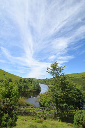 View from the public path along the shore at Meldon Reservoir on Dartmoor, England, Taken from Longstone Hill looking towards Sourton Tors. Stock Photo