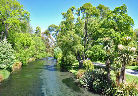 The River Avon flowing through the beautiful botanical gardens in Christchurch, New Zealand Stock Photo
