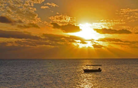 The tranquil beaches of the  South Pacific Ocean really are paradise found. This sunset is over the Coral Coast on the island of Viti Levu (Fiji)