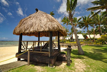 The tranquil beaches of the  South Pacific Ocean really are paradise found. This thatched beach hut overlooks the Coral Coast on the island of Viti Levu (Fiji)