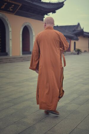 garb: traditional monk walking around the buddha temple