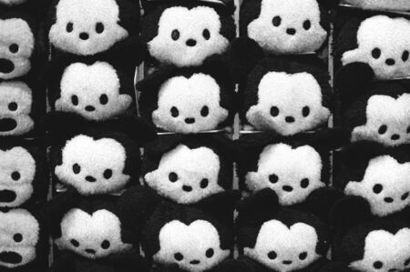 soft toys: Rows of soft toys in the supermarket black and white Stock Photo