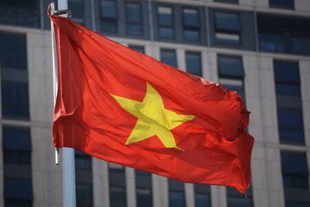 vietnam flag: Red Vietnam flag waving against the building