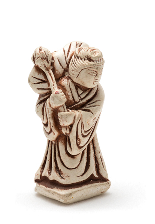 Netsuke of old woman in a dressing gown. A miniature sculpture, which was used as a button-like trinket in traditional Japanese clothes kimono kosode, which was devoid of pockets.