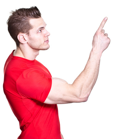 something athletic: athletic young man pointing at something
