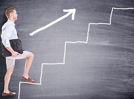Student stepping up stairs of career ladder photo