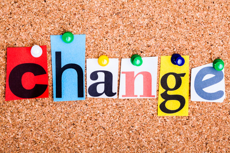 The word Change in cut out magazine letters pinned to a cork notice board