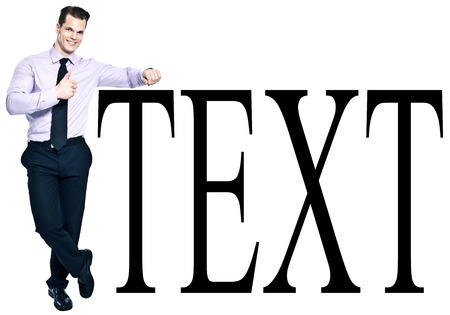 Cheerful young businessman showing thumb up while leaning against sample text - Add your own text here Standard-Bild